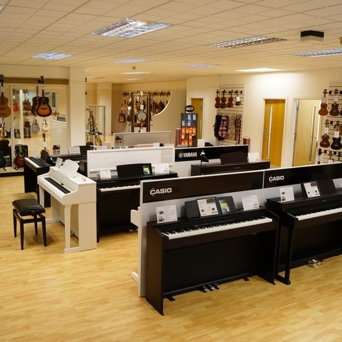 Our top floor is full of Pianos, Acoustic Guitars, Ukuleles, Banjos, Brass and Woodwind and more!
