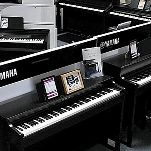 Huge piano showroom, with Digital Pianos from Yamaha, Roland and Casio.